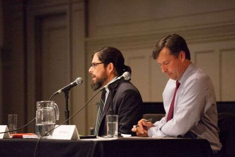Roger Valdez (l) and representative Matt Manweller state their case during the debate.