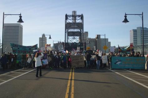 Villalpando leading a NWDCR march at the Port of Tacoma, WA, Nov 21, 2015