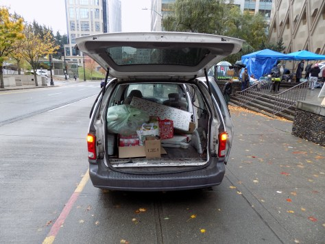 Image 6 Caption--A volunteer's vehicle is loaded with supplies as the camp is forced to move.