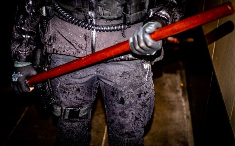 Police  Office Readying Baton During George Floyd Unrest