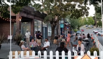 """Photo depicting an outdoor eating """"patio"""" in Columbia City."""