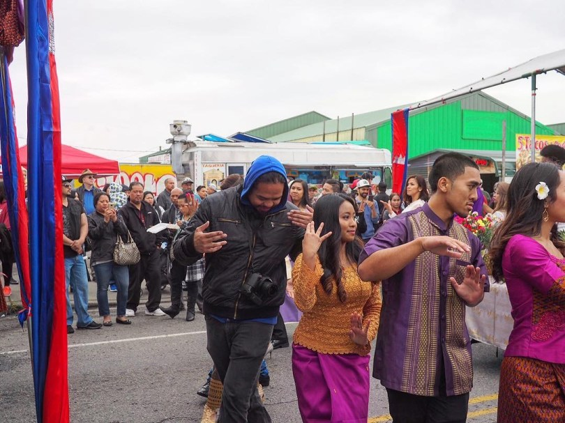 Vannra Yan and Sophia Som participate in Rom Vong, a traditional group dance, as part of CCAW's White Center Cambodian New Year Street Festival.