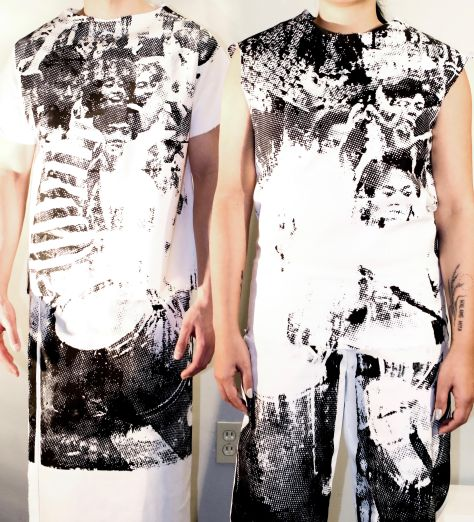 Two individuals stand wearing Diego Binuya's work: a screen-printed image from the 1986 People Power Revolution in the Philippines onto both garments which are meant to be worn together.