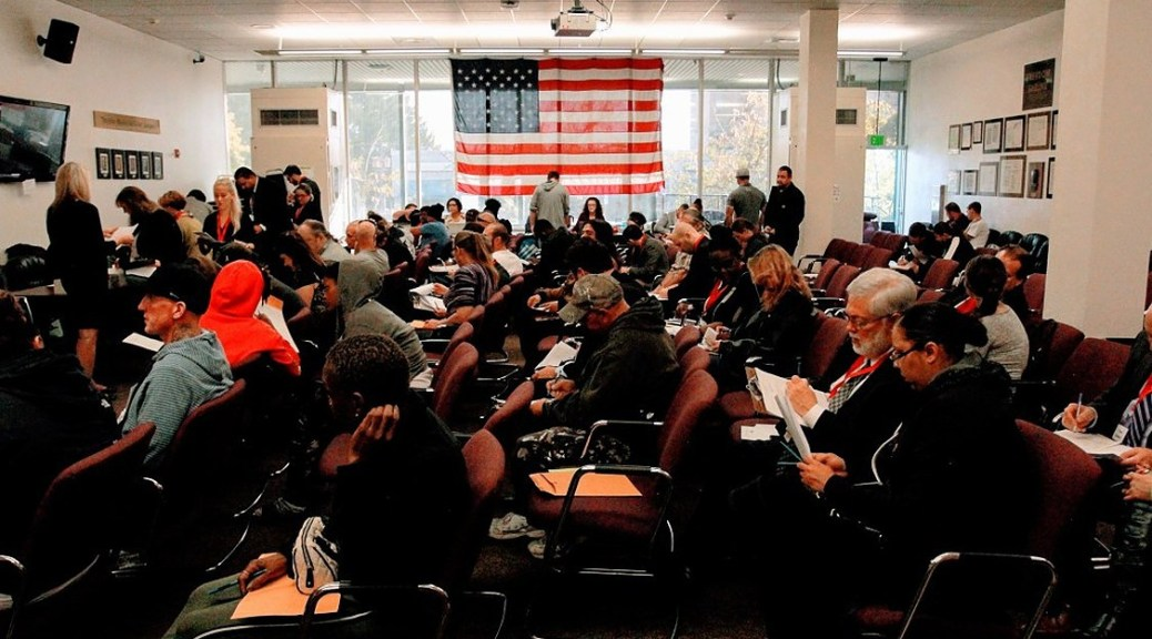 Photo of Pierce County residents attending an event to receive legal assistance in reducing their LFO debts.