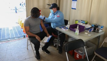 A patient receives a COVID-19 vaccination at a City of Seattle vaccine pop-up in Rainier Beach.