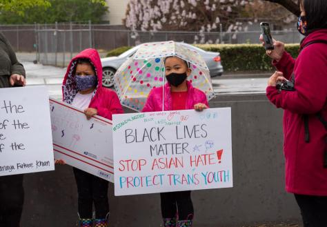 Photo of young girls holding signs