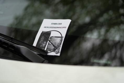 Activists leave flyers on car windows and utility poles urging people to boycott Starbucks.