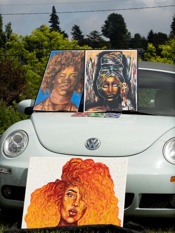 Art created by Monie Love was on display atop a powder-blue Volkswagon Beetle.