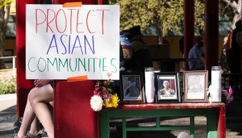 """Photo of a memorial to Donnie Chin with a sign that reads """"Protect Asian Communities."""""""