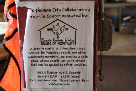 Photo of a sign for Hillman City Collaboratory's homeless drop-in center run by volunteer Victor Straub.