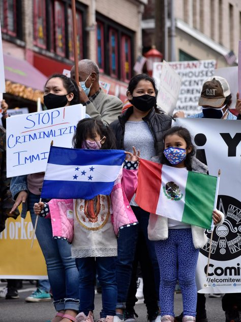 Youth protesters proudly carry the flags of Honduras and Mexico.