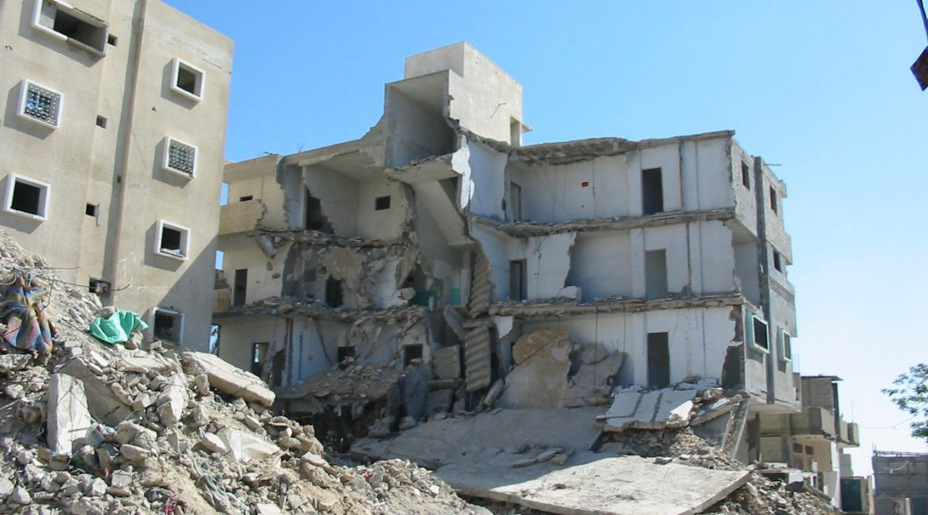 Photo of a building destroyed by violent conflict in Gaza.