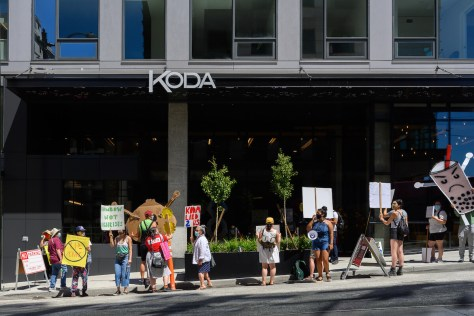 A coalition of community groups protest the grand opening of KODA condos in the CID on February 25, 2021. The demonstration was organized by the CID Coalition (aka Humbows Not Hotels), Parisol (Pacific Rim Solidarity Network), and MPOP (Massage Parlor Outreach Project).