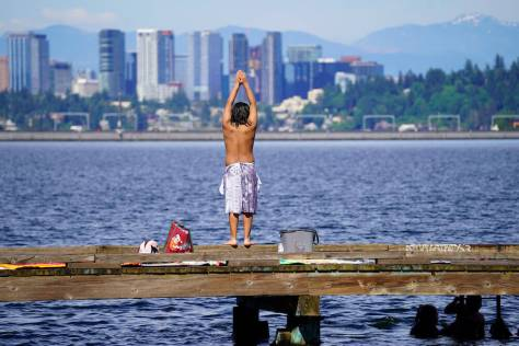 A boy gets ready to dive into Lake Washington from a pier at Mount Baker Park. (photo: Susan Fried)