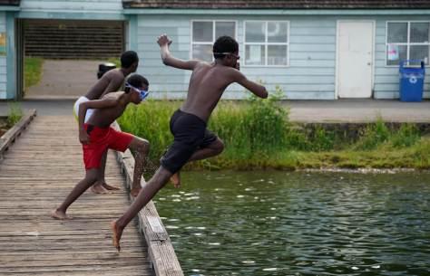 A group of friends jump into Lake Washington. (Photo: Susan Fried)