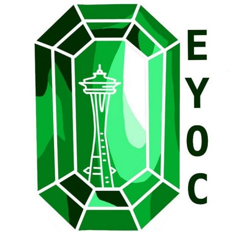 """Logo of a bright-green emerald with a white outline of Seattle's Space Needle reflected inside. Dark-green text reading """"EYOC"""" runs down the right side of the emerald."""