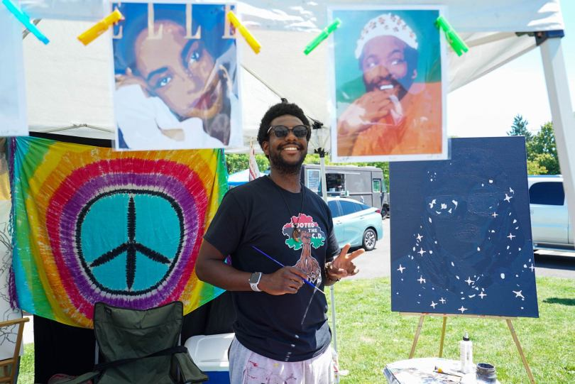 A vendor proudly displays their wares at King County Equity Now's Juneteenth Freedom March and Celebration.
