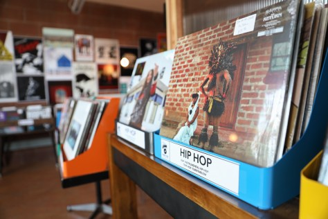 """Photo of the vinyl selection inside of Empire Roasters & Records, focusing on the blue bin labeled """"hip hop."""""""
