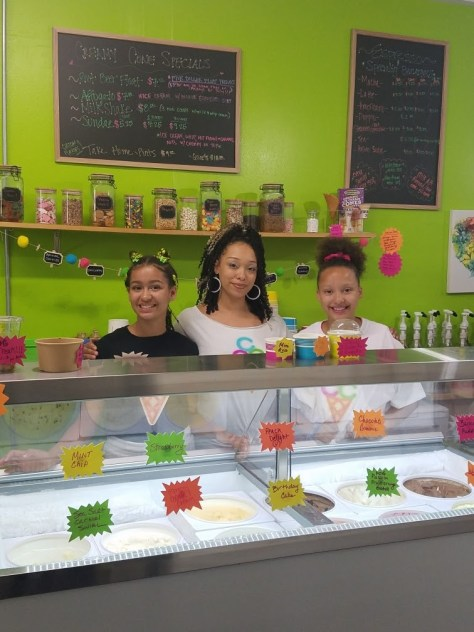 Owner Ashanti Mayfield (middle) and her daughters Ashima (left) and Soulé (right) Robinson inside Creamy Cone Cafe in Rainier Beach.