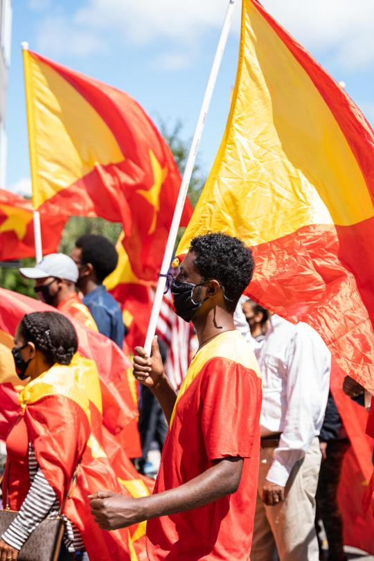 A man holds up a Tigray flag during the march.