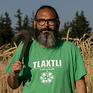Headshot of Edgar Franks standing in a field.