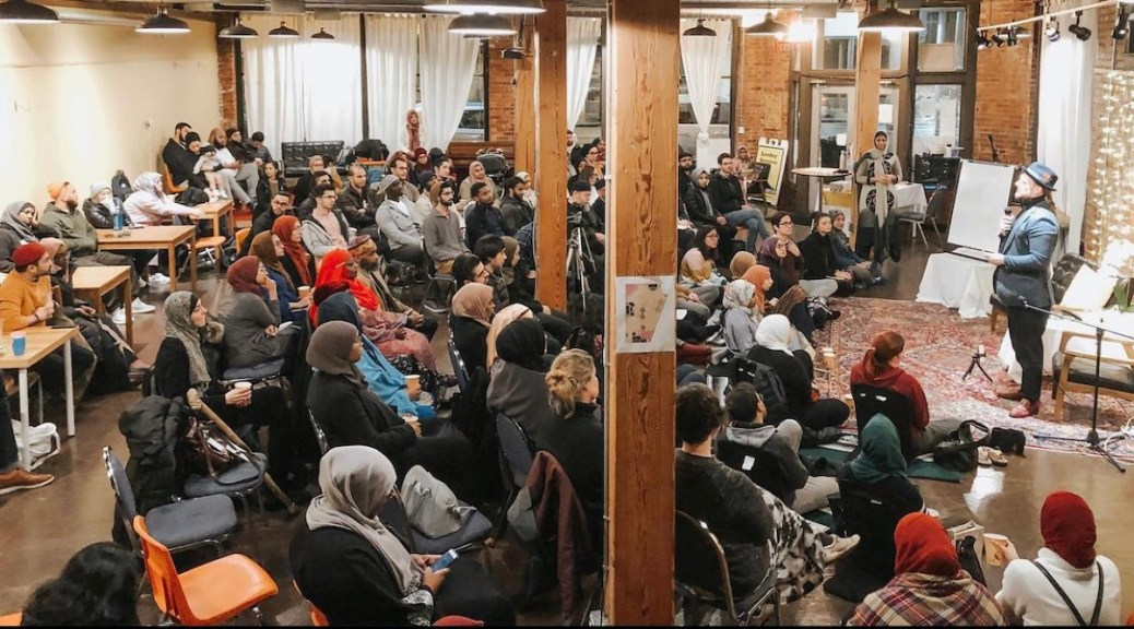 Featured Image: Wasat members gathered for a speaking event. (Photo courtesy of Wasat)