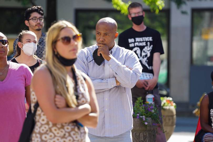 Kaloni Bolton's mother Kristina Williams' attorney James Bible listens to a speaker during the #BreatheforKaloni rally on Saturday, July 24, 2021, at Westlake Park.