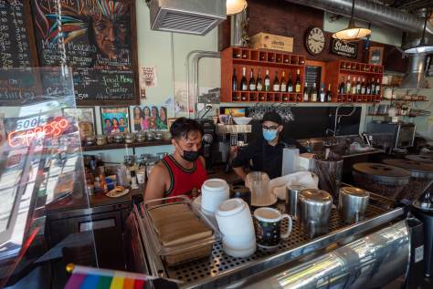 Michael Alcantara and Manuel Rodriguez work behind the counter at The Station Coffee Shop.