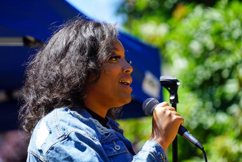 Samara sings the Black National Anthem at the start of the Rally