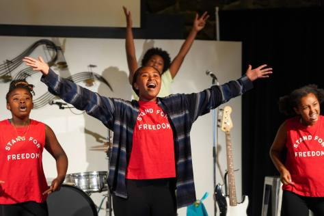 """Emia Beaver, 14, sings with the cast of """"Story of an Off-Brand Band"""" during a run-through of the musical on Wednesday, July 21, 2021, at the Acts on Stage Theatre."""