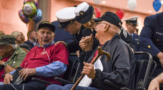 Sailors escort veterans during a Puget Sound Honor Flight welcome home ceremony