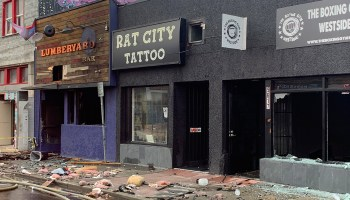 Photo of the burned exterior of the Lumber Yard Bar, Rat City Tattoo, and The Boxing Gym Westside in White Center.
