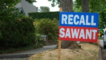 """Photo depicting a blue and red sign that reads """"Recall Sawant"""" in white text."""