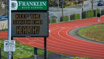 A community member walks at the track outside of Franklin High School in South Seattle.