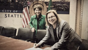 Lisa Judge and unknown person. Featured image is via the Seattle City Council's Flickr page and is used under a Creative Commons 2.0 license (CC BY 2.0). (Edited by Emerald staff)