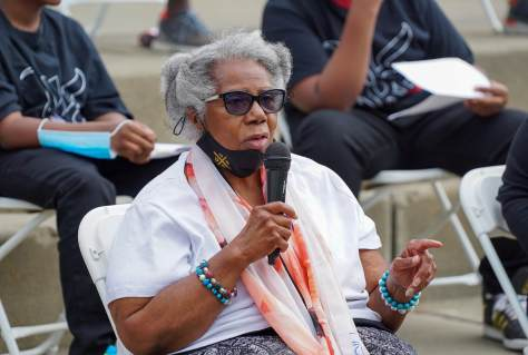 Harriet Walden says a few words during a panel discussion about gun violence