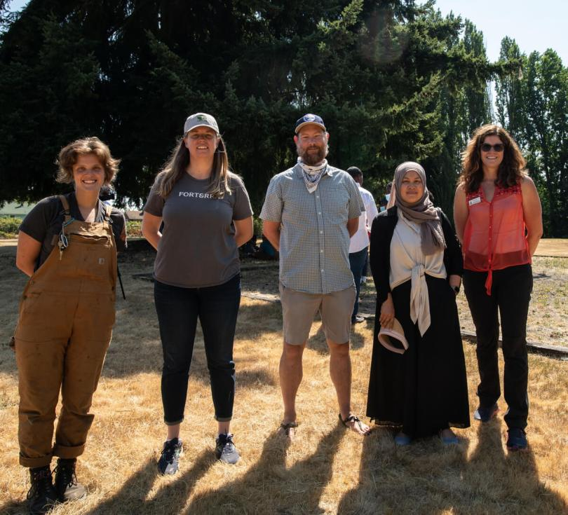 Photo depicting a group of individuals part of the Hilltop Park restoration project at Hilltop Park.