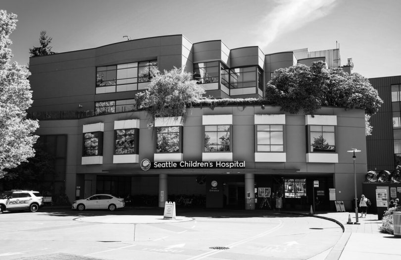 A black-and-white photo of the exterior of Seattle Children's Hospital.