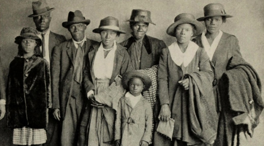 African American extended family arriving in Chicago from the rural South, ca. 1920. (Photo via Everett Collection/Shutterstock.com)