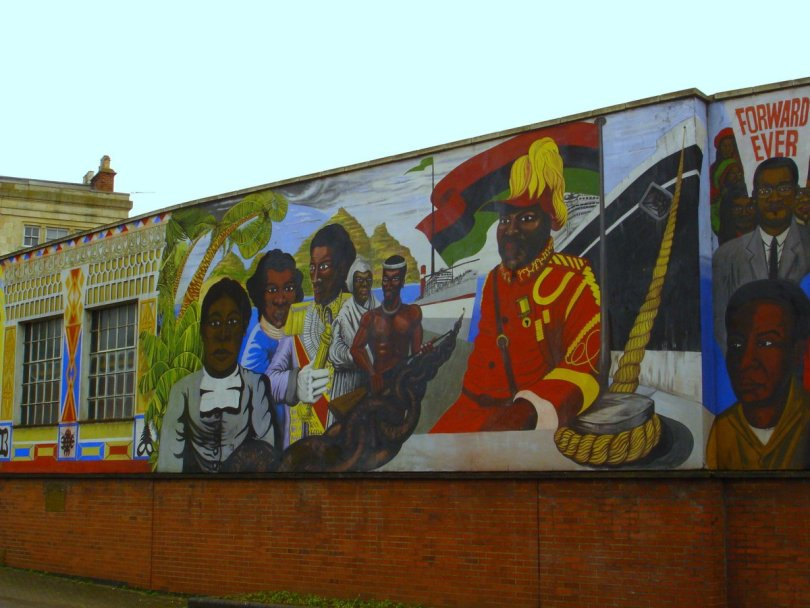 photo of mural of Black historical figures on building wall