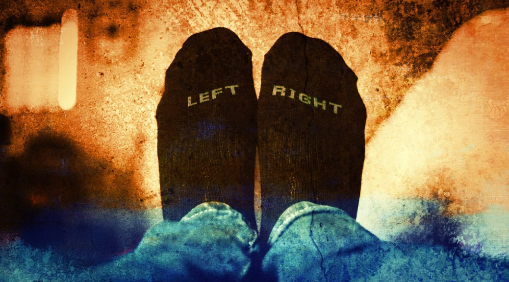 """Photo depicting a close-up of a pair of dark socks on feet. One sock says """"LEFT"""" and the other """"RIGHT."""" The background is an explosion of orange and browns."""