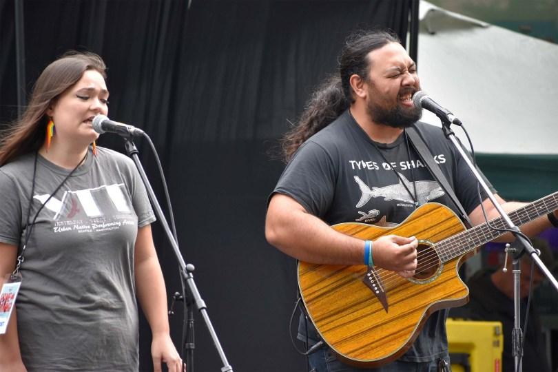 Photo depicting Nicole Suyama performing alongside Logan Ulavale on guitar.