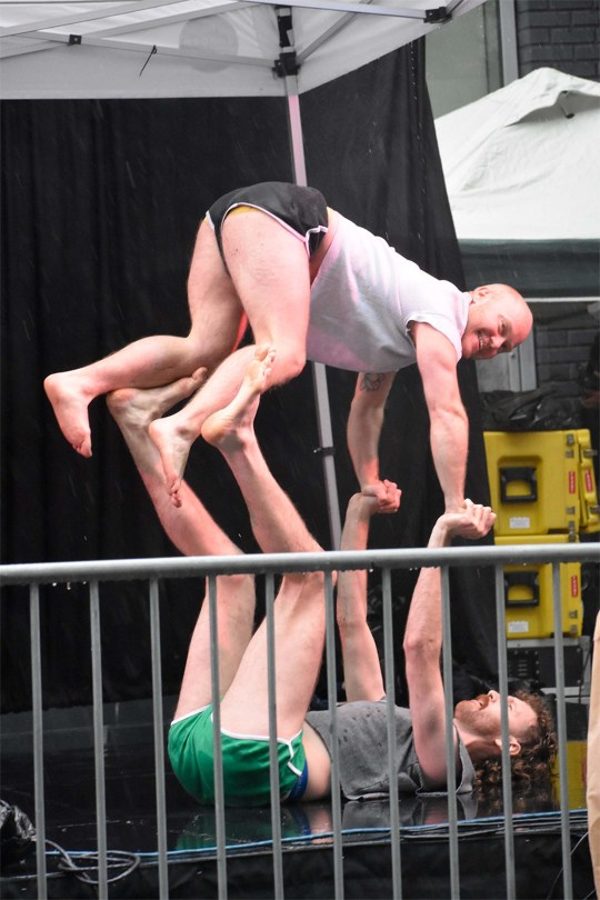 Photo depicting Elby Brosch and Shane Donahue performing a partnered contortion act.