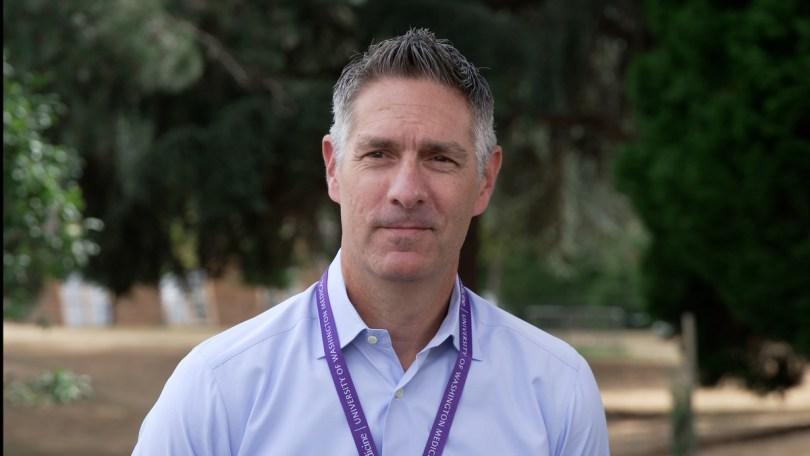 Photo depicting a headshot of Dr. Jonathan Drezner wearing a purple University of Washington Medicine lanyard.