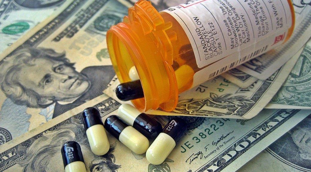 Photo depicting a prescription bottle spilling black-and-yellow pills across a background of twenty-dollar bills.