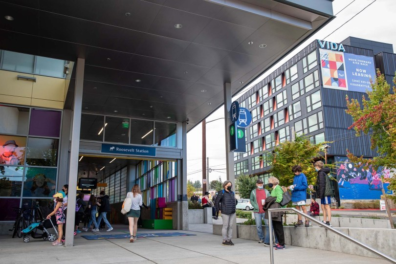 Photo depicting the exterior of the Roosevelt Station, a newer apartment complex stands in the background.