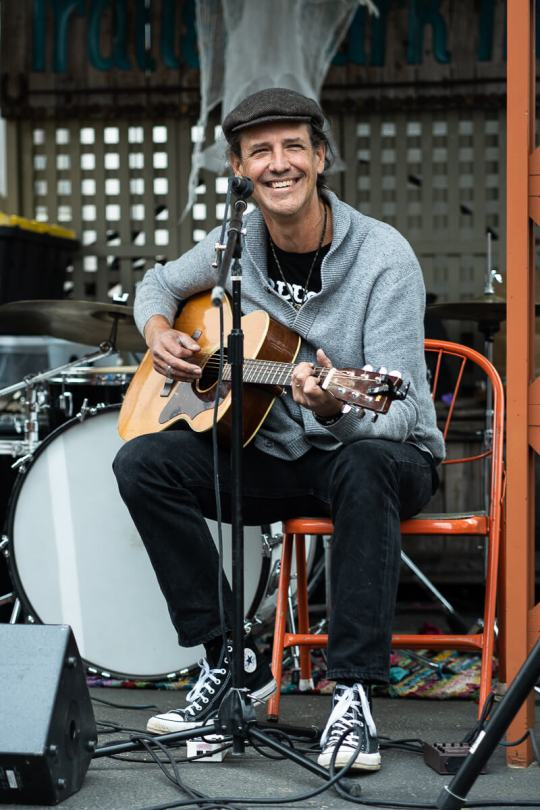 Arlan Lackie of local band Lo-Liner smiles during his live performance.