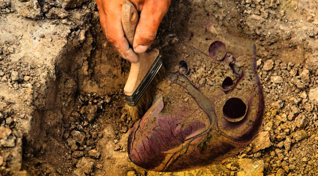 Photo collage illustration: An archaeologist uses a paintbrush to excavate a purplish human heart from brown dirt and rocks. Original photo by Mariana Rusanovschi/Shutterstock.com; photo editing by Emerald staff.
