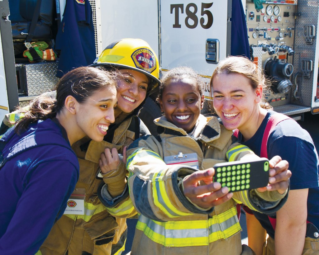 women don firefighter gear and take a selfie at Santa Clara County Joint Public Safety Women's Career Day on Oct. 16 2016