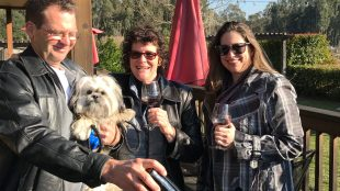 Ron and Toni Davidson, with their dog Cosmo and friend Angela Kimball enjoy a bottle of Solis' finest. Photo: Bev Stenehjem